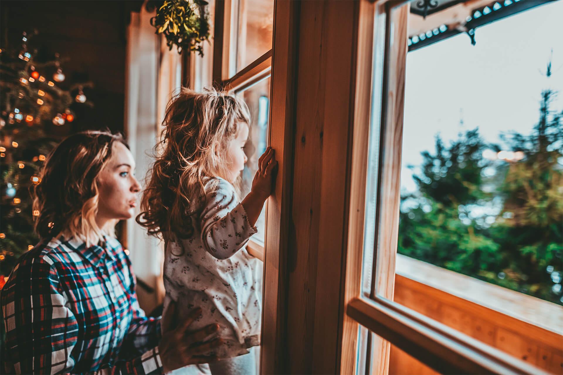 kid and mom watching window