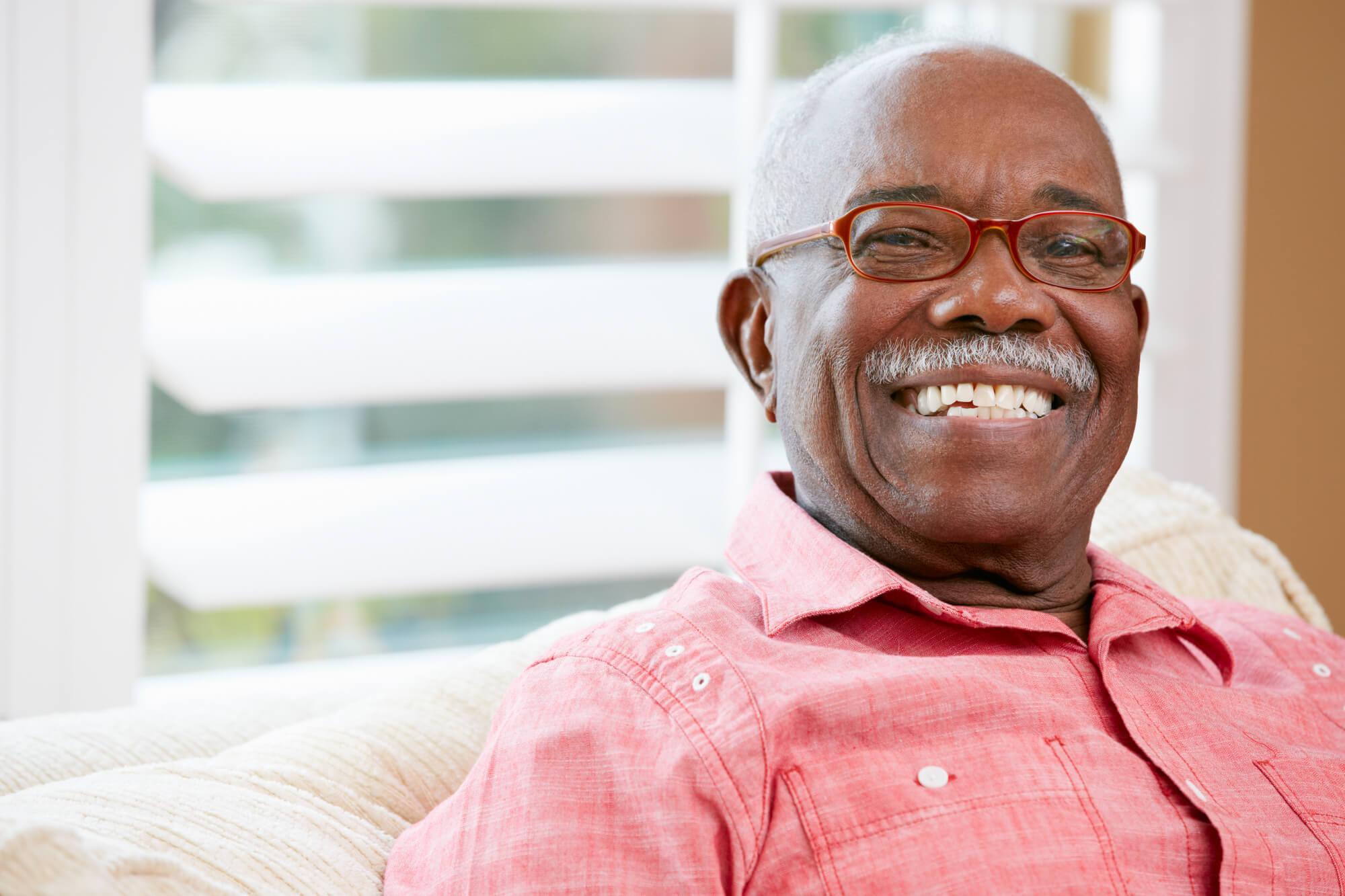 Smiling elderly man at Memory Care in Geneva