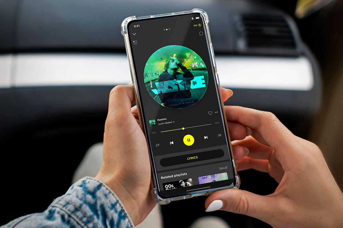 Person scrolling through TREBEL app while in the car