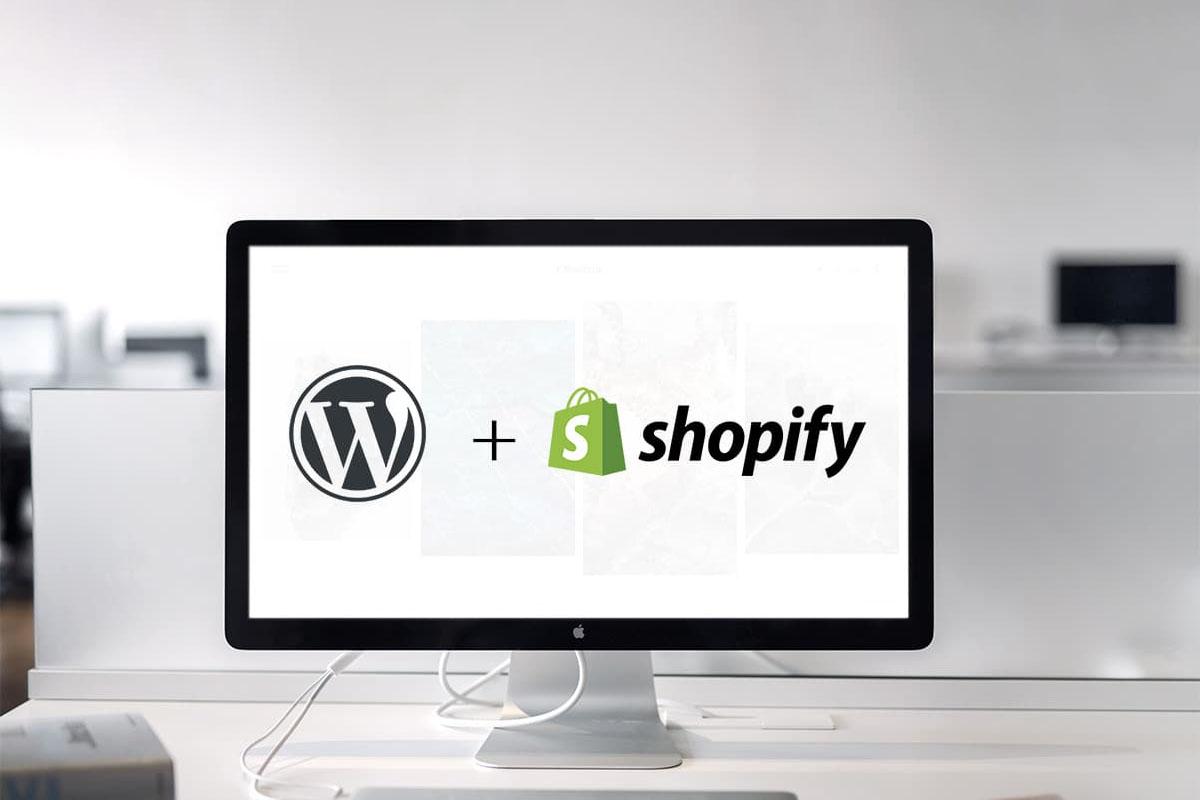 Imac computer showing a screen Wordpress and Shopify logos
