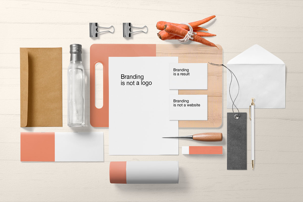 Brand identity spread with business cards, stationary, and packaging design