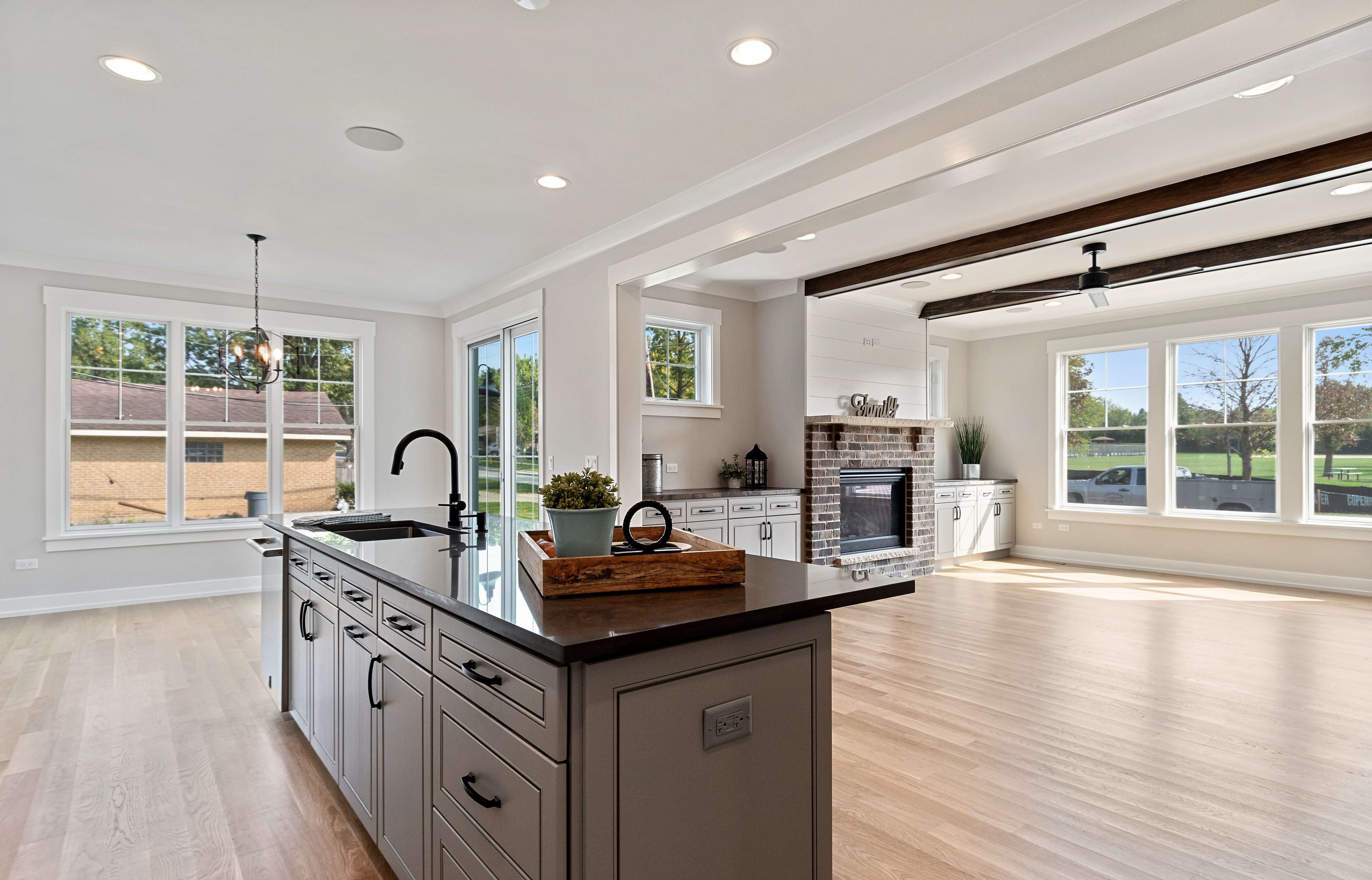 Open floor plan kitchen showing off kitchen and living room