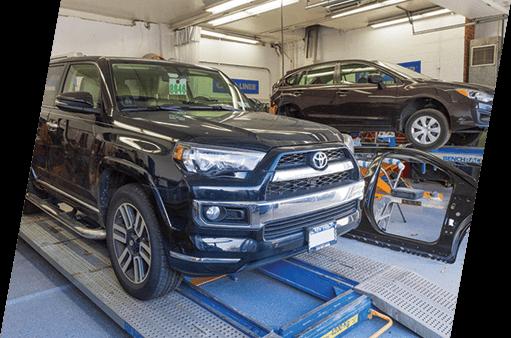 Two cars being repair on racks