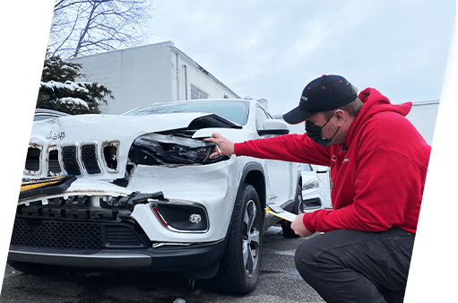 Don Joe Insurance adjuster assessing auto collision damage to white jeep