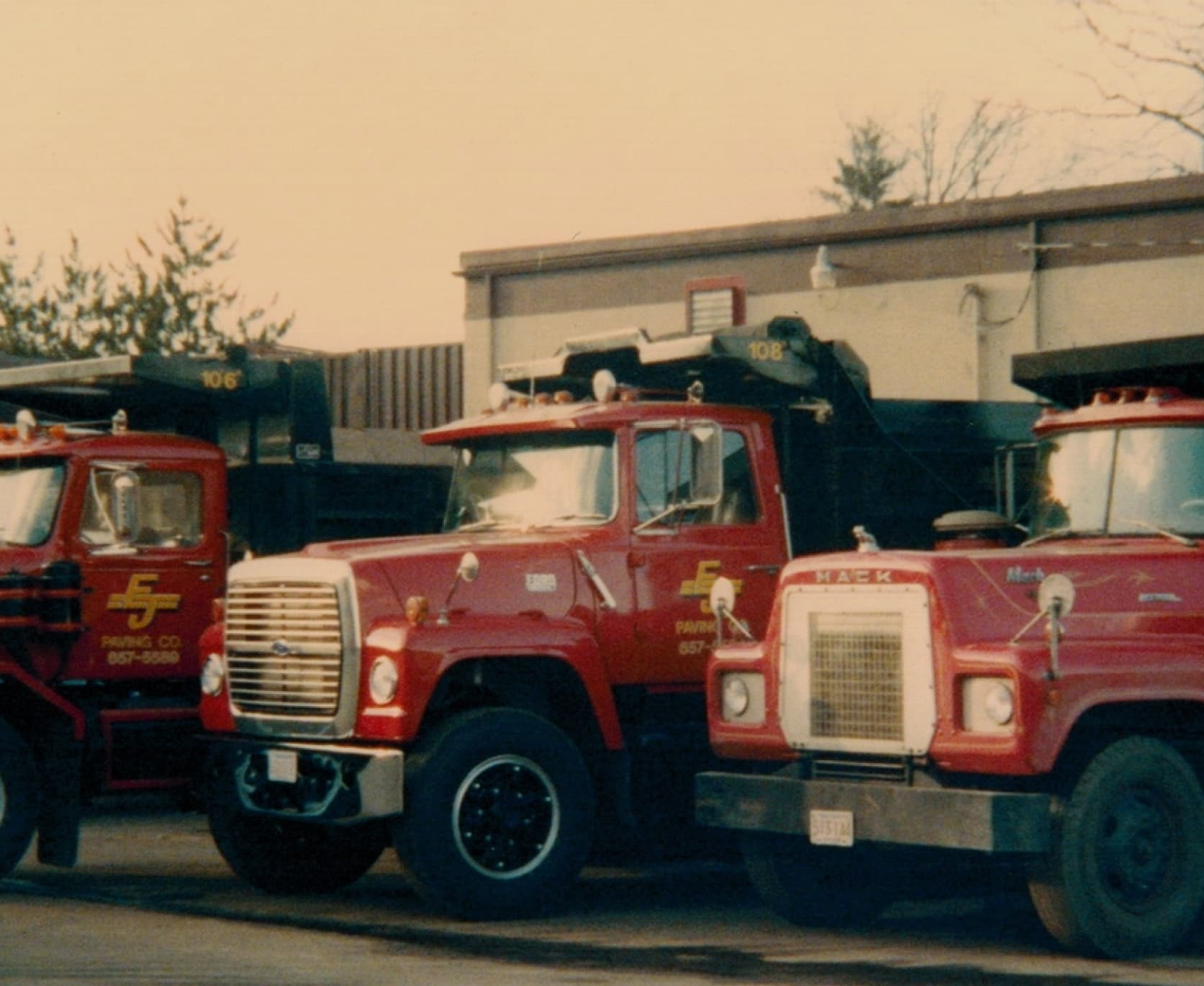 A picture of EJ Paving dump trucks from the early days of the company.