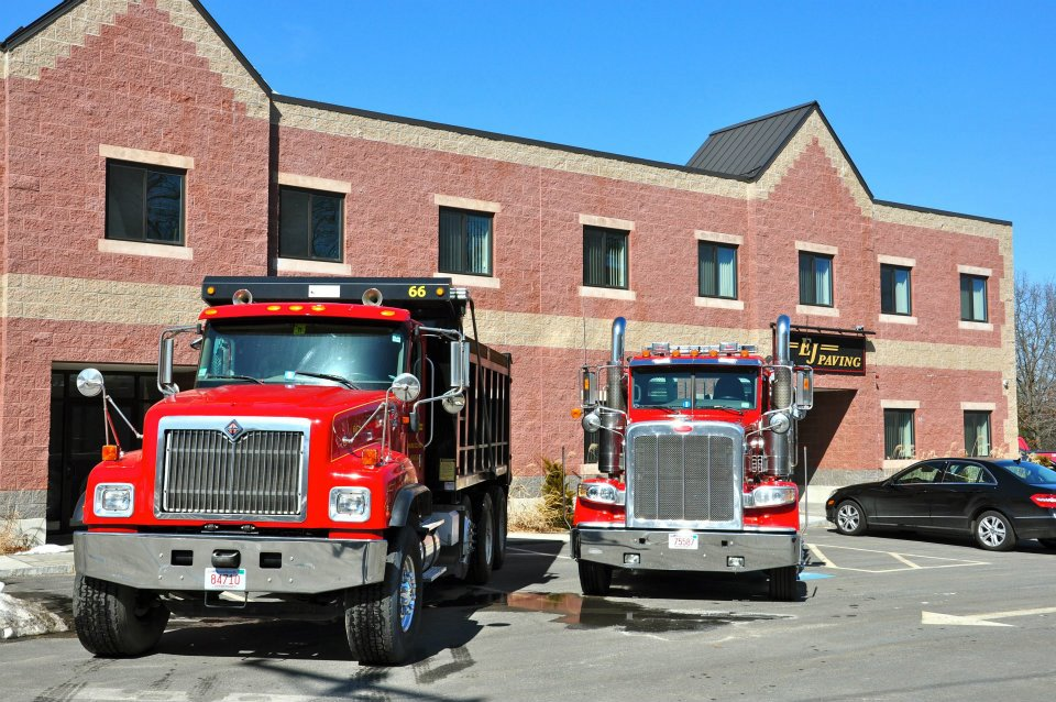 Photo os EJ Paving dump trucks in front of Methuen, Ma office.