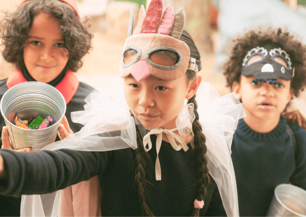 Kids in a costume playing.