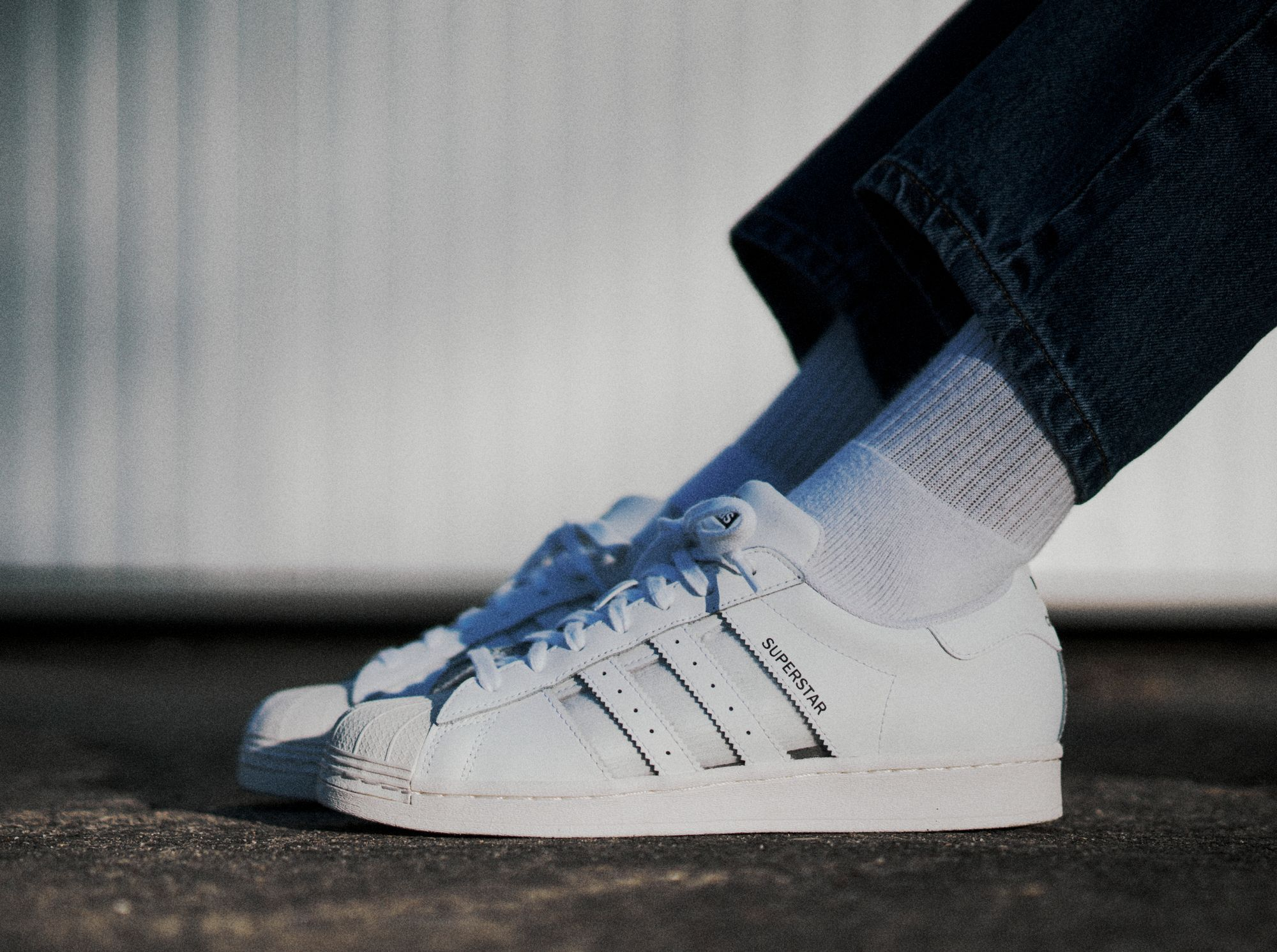 adidas Originals Superstar with transparent stripes on feet shot