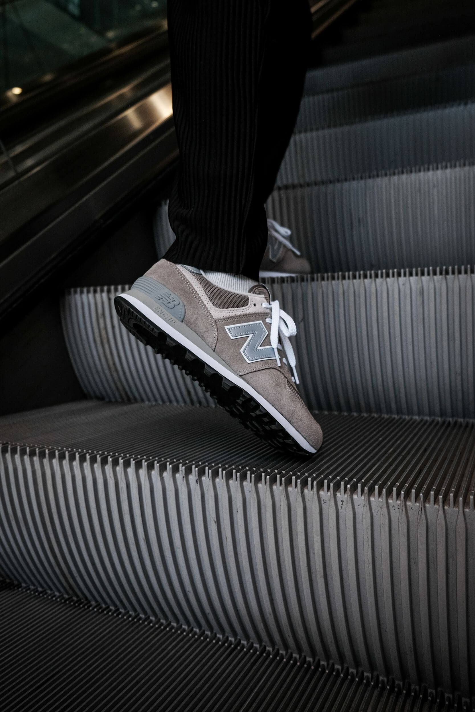 on feet photo of the New Balance M574EGG - The most New Balance shoe ever.