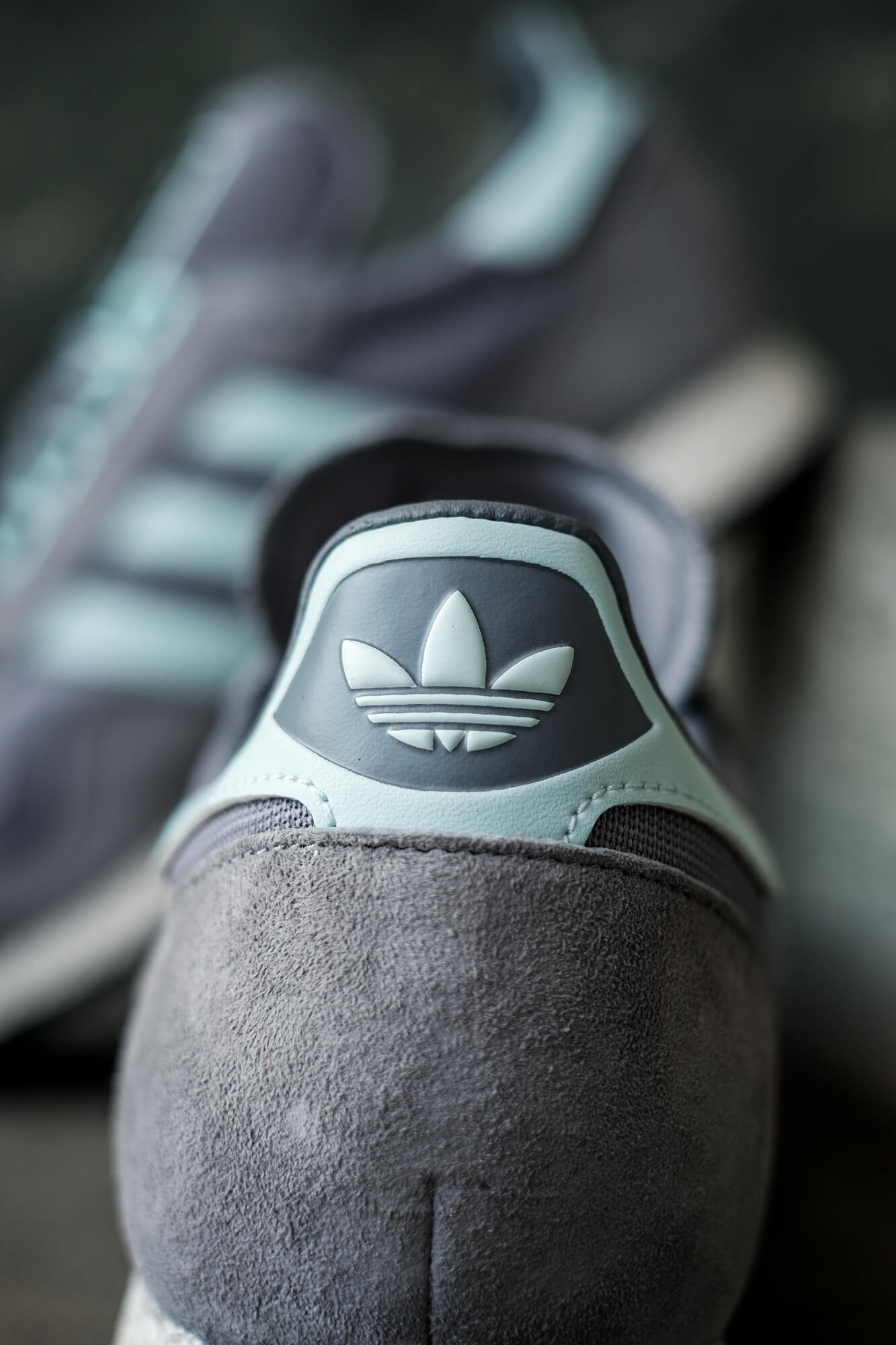detail of the heel, inverted adidas trefoil of the adidas New York OG sneaker