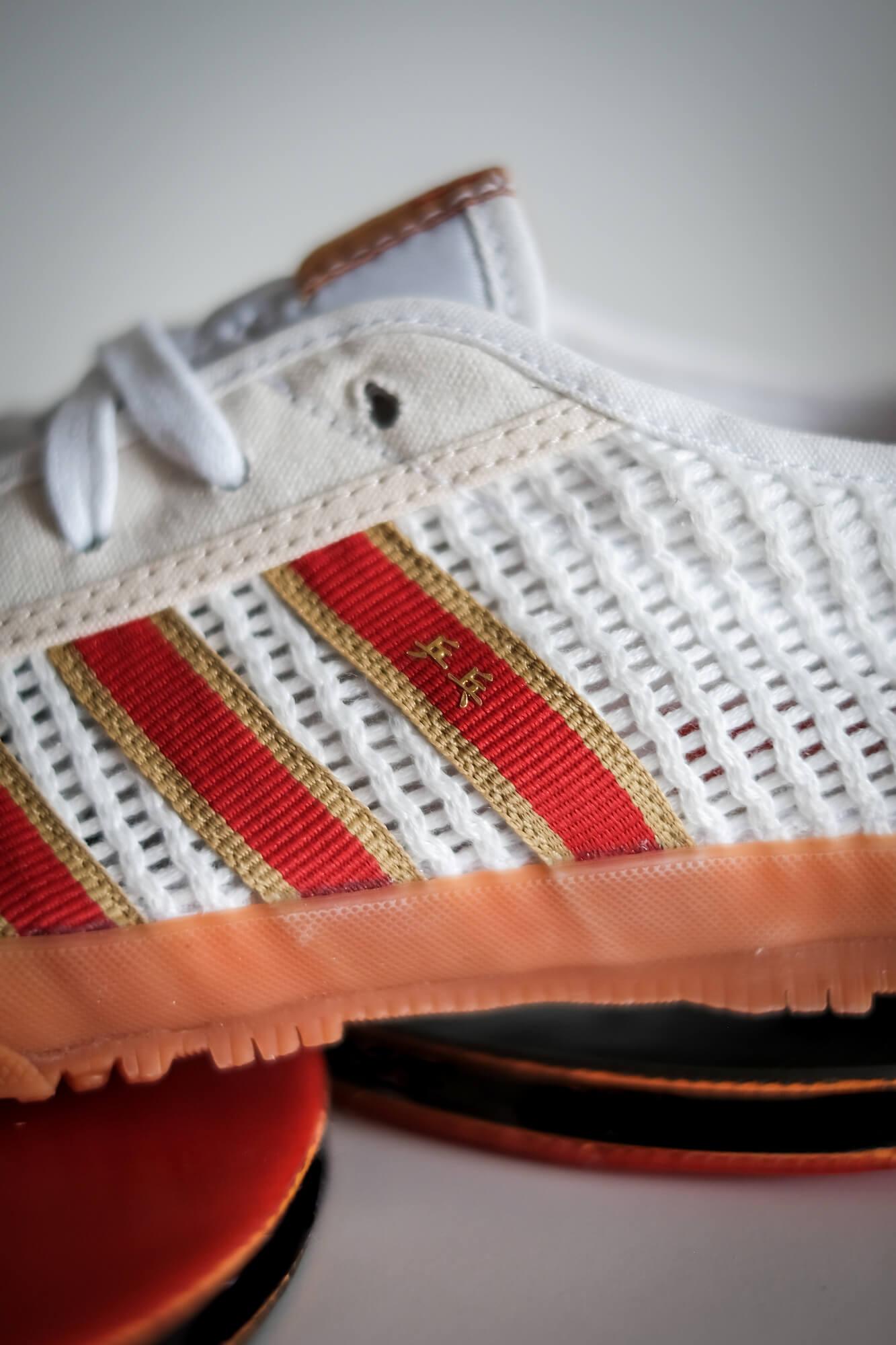 details on the adidas - Tischtennis - footwear white/team college red/core white - H01796
