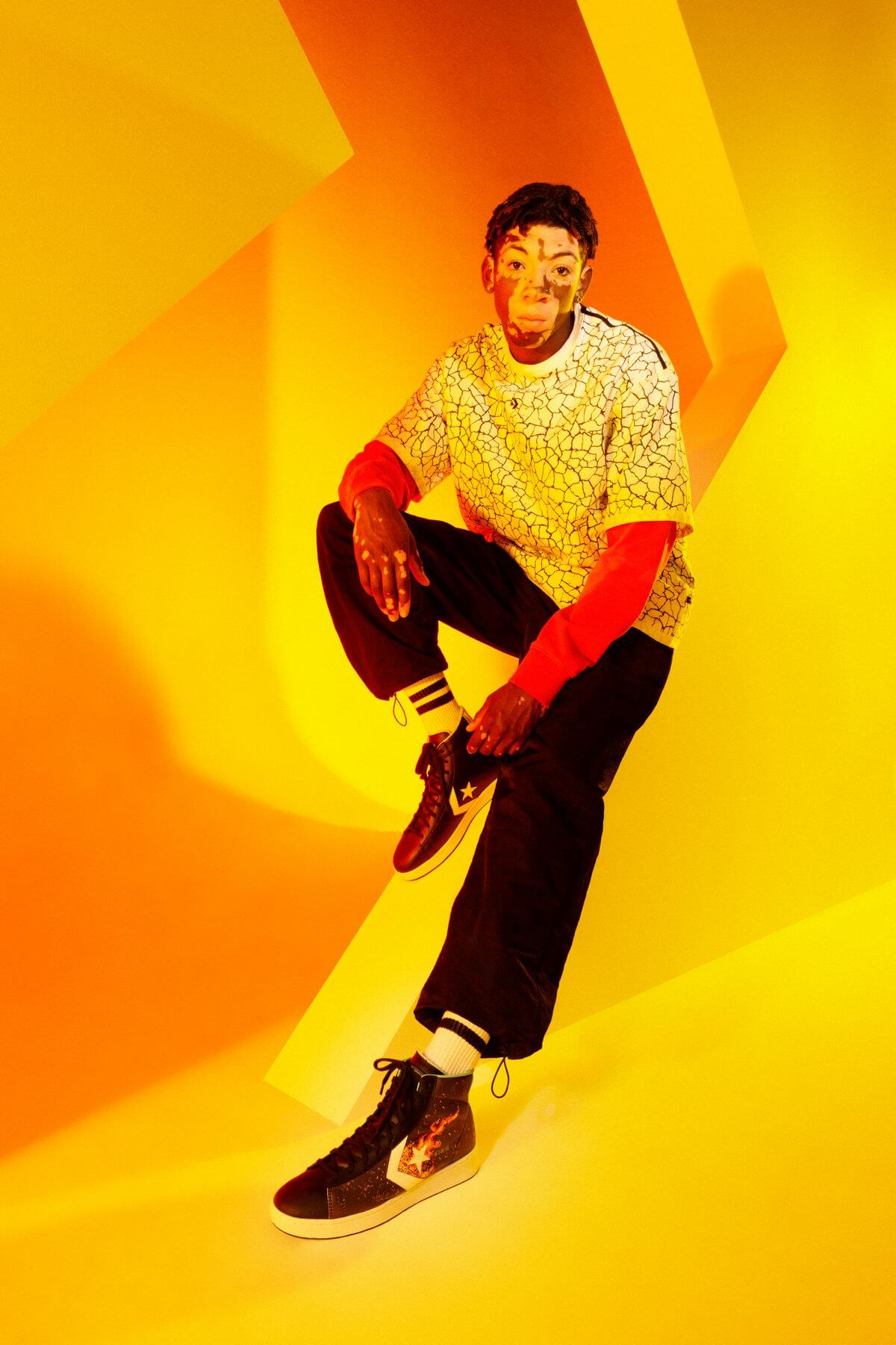 on feet photo of the Converse x NBA Jam - Pro Leather - black/tart orange/white - 171313C