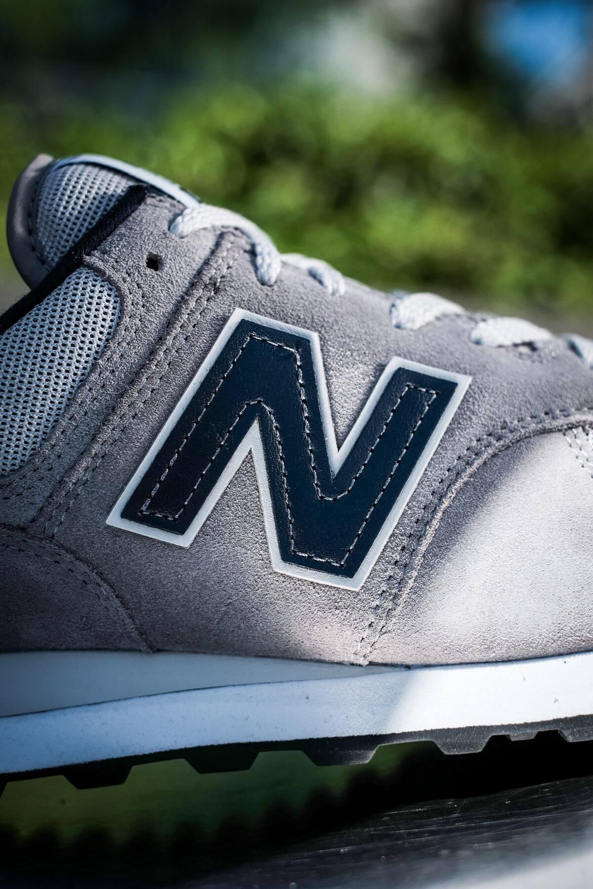 details N branding - New Balance - 574 History Class Pack - ML574BE2 - grey/navy