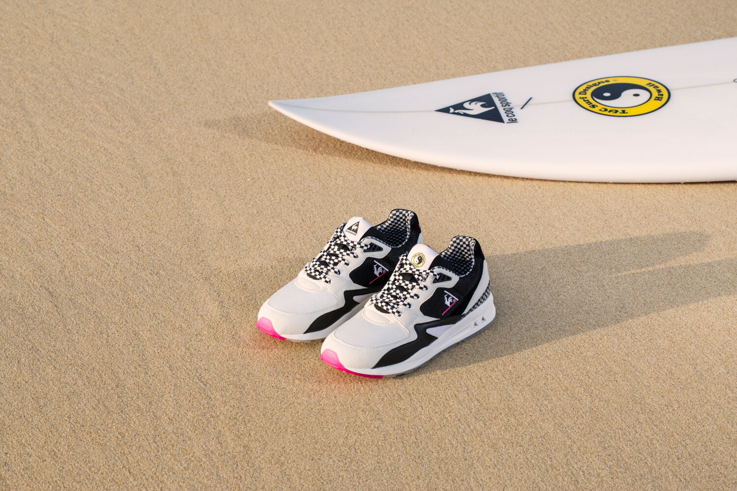 Le Coq Sportif x Town&Country Surf Designs LCSR800 and surfboard