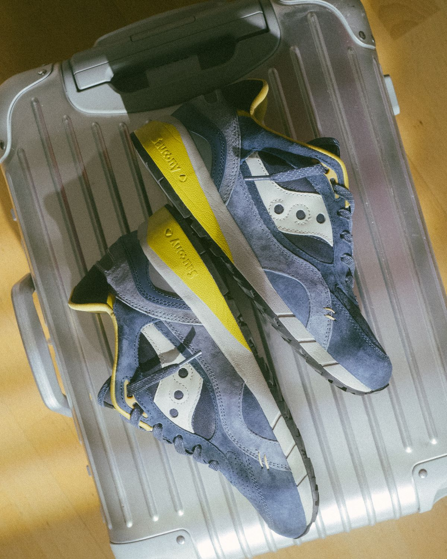 "rimowa - suitcase - Saucony - Shadow 6000 - ""DestinationUnknown"" - navy/yellow - S70587-2"