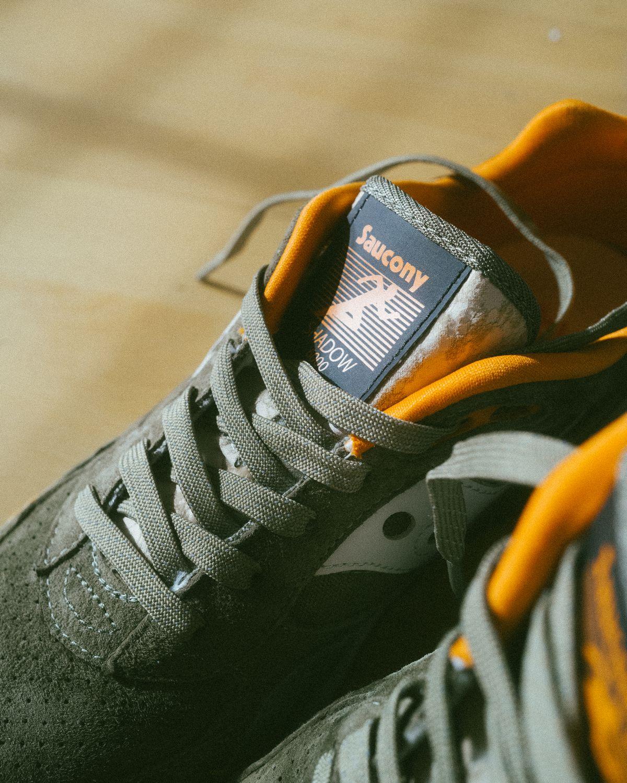 "detail photo of the Saucony - Shadow 6000 - ""DestinationUnknown"" - olive/orange - S70587-1"
