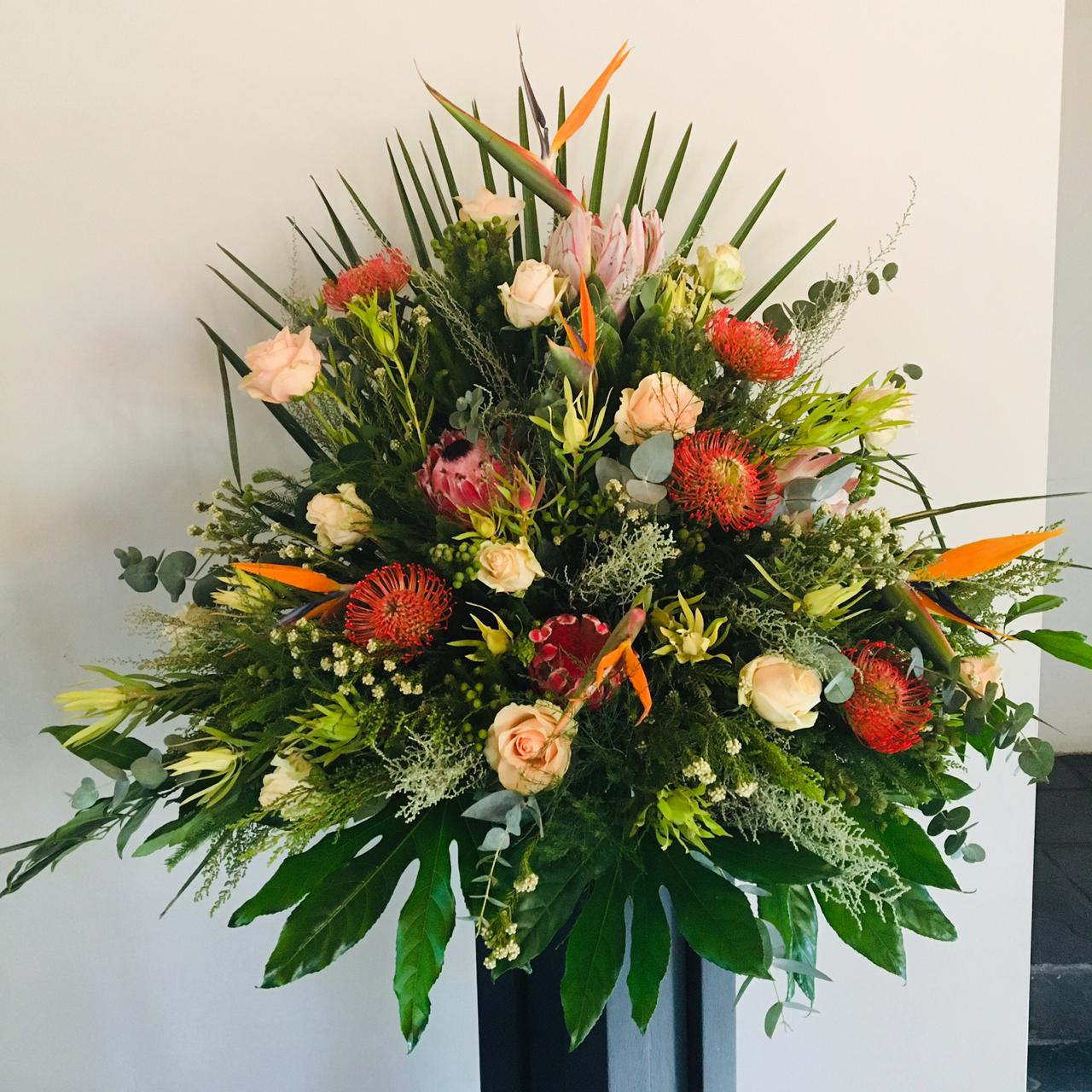 Cape flower arrangements with pincushions, roses and strelitzias (seasonal) from