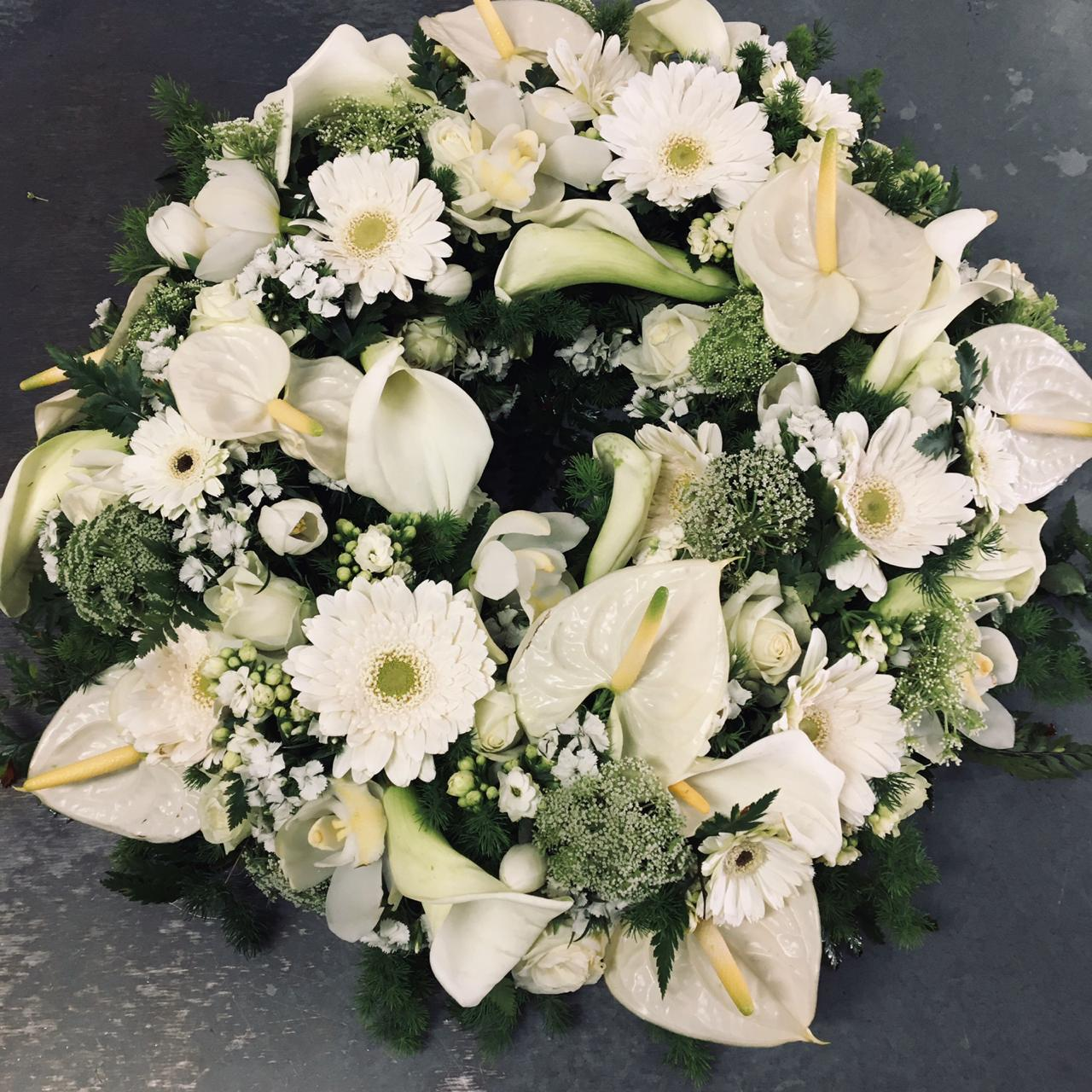 White flowers in the shape of a circular wreath from