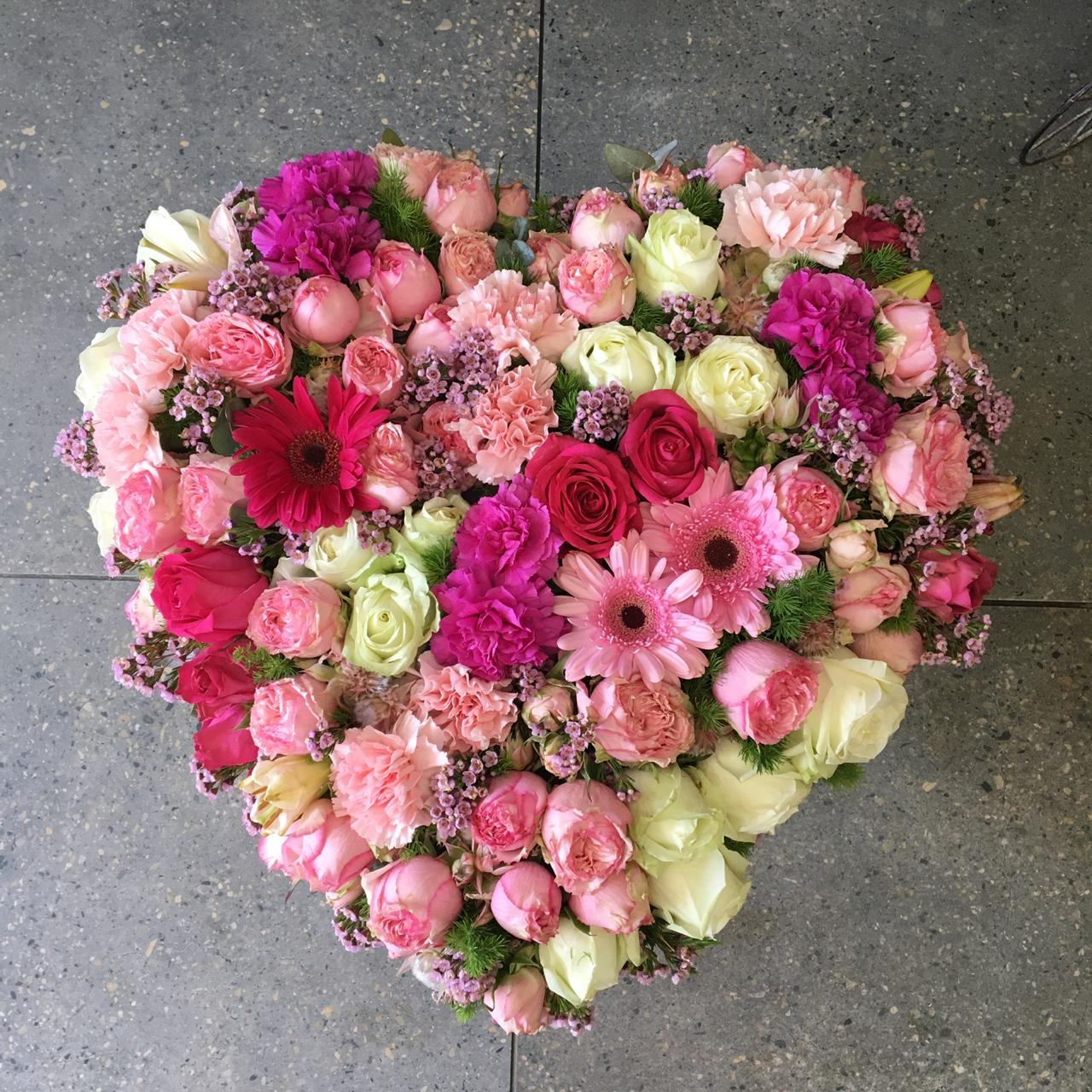 Flowers placed in the shape of a heart