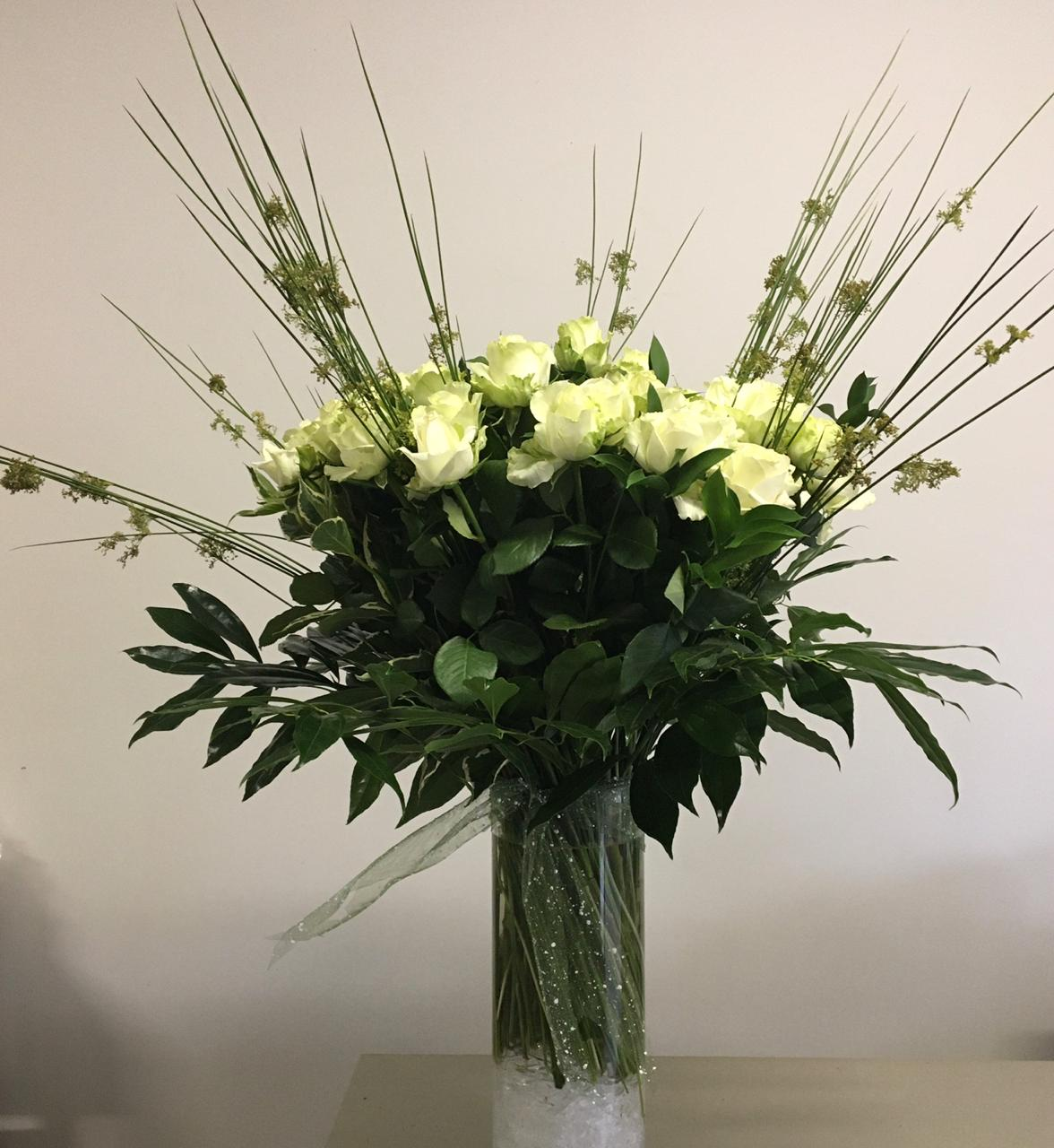 White Rose arrangements in a vase from