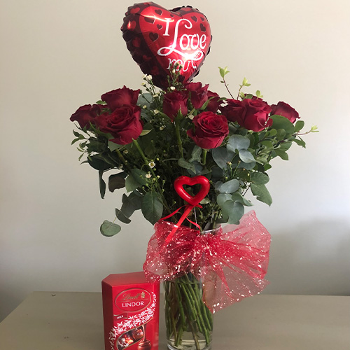 Red Roses with filler in a glass vase with Ballon and Box of Lindor Chocolates