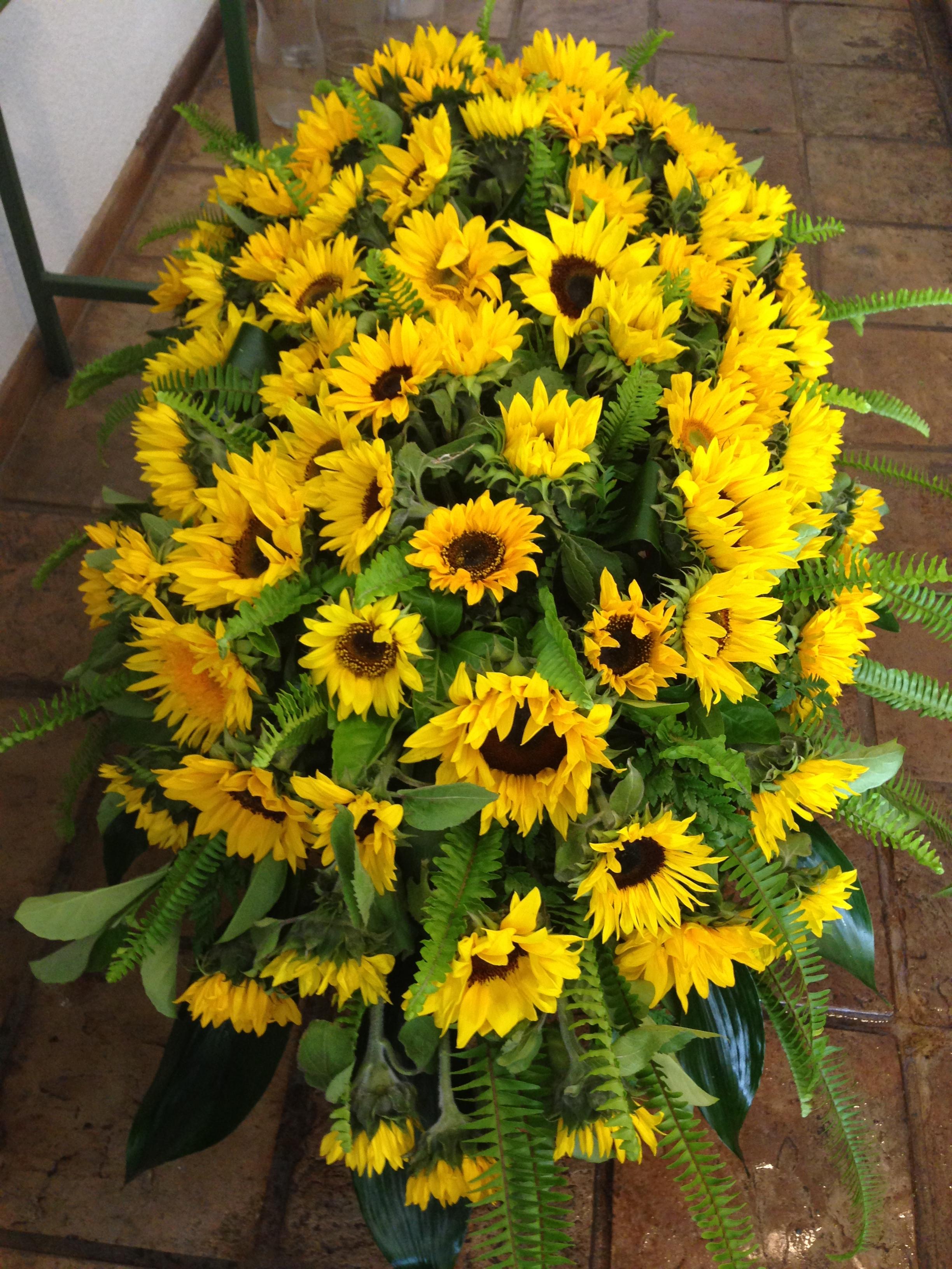 Sunflowers and fesh greenery