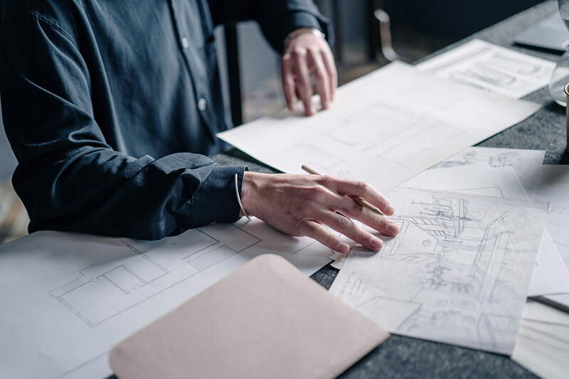 Architect drawings spread on a table
