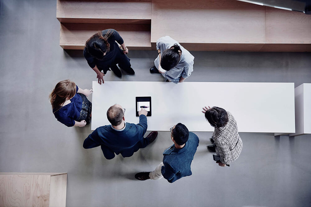 top view of staff members around a table