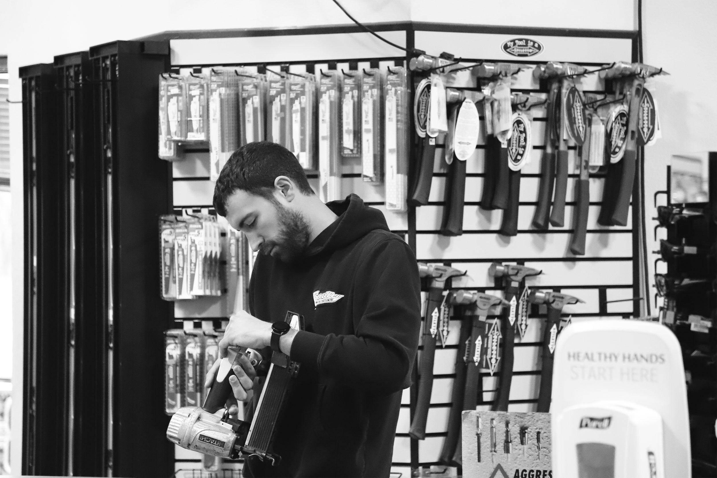 Bradley Tools employee inspecting nailer for repair