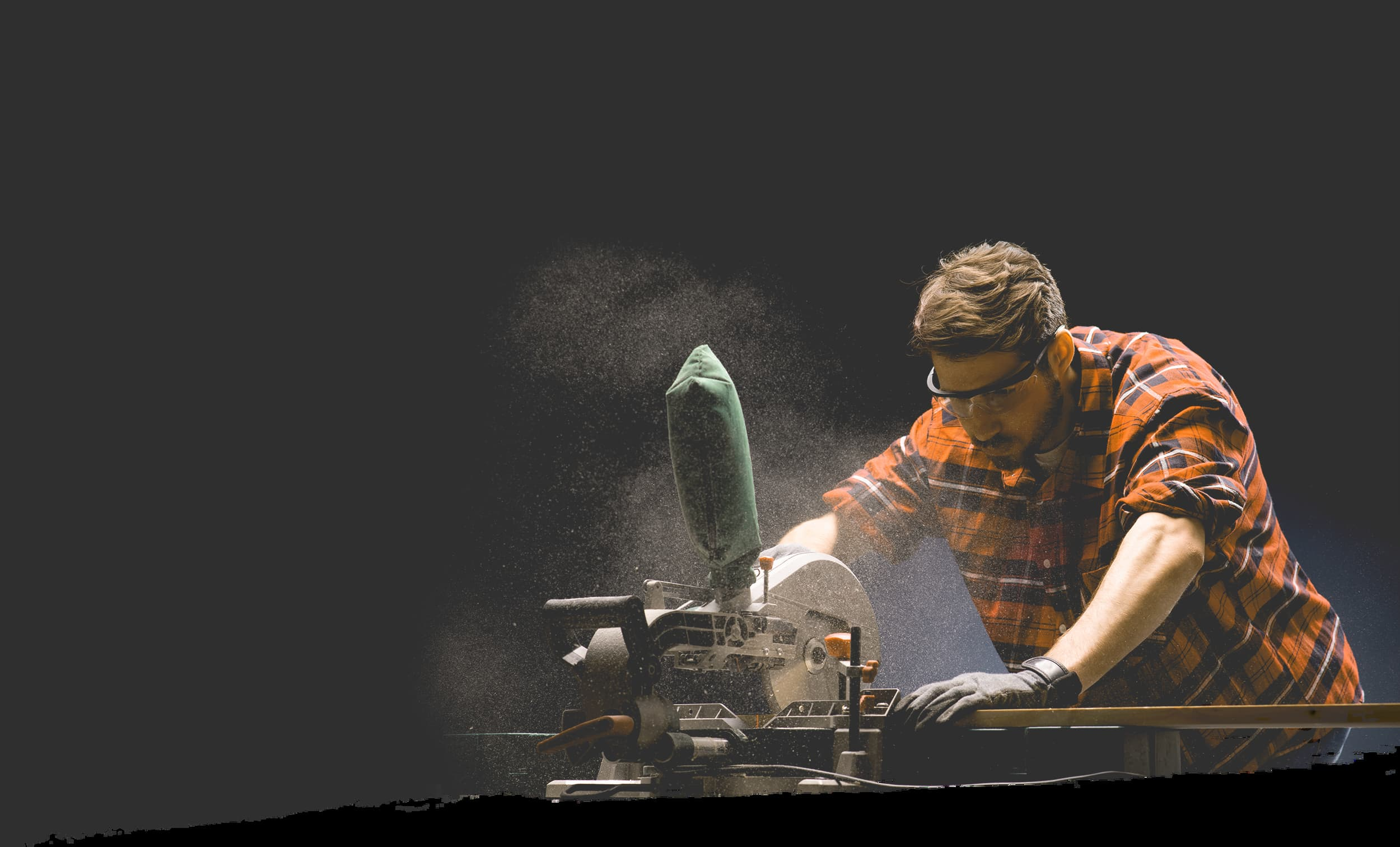 Man in flannel using power tools