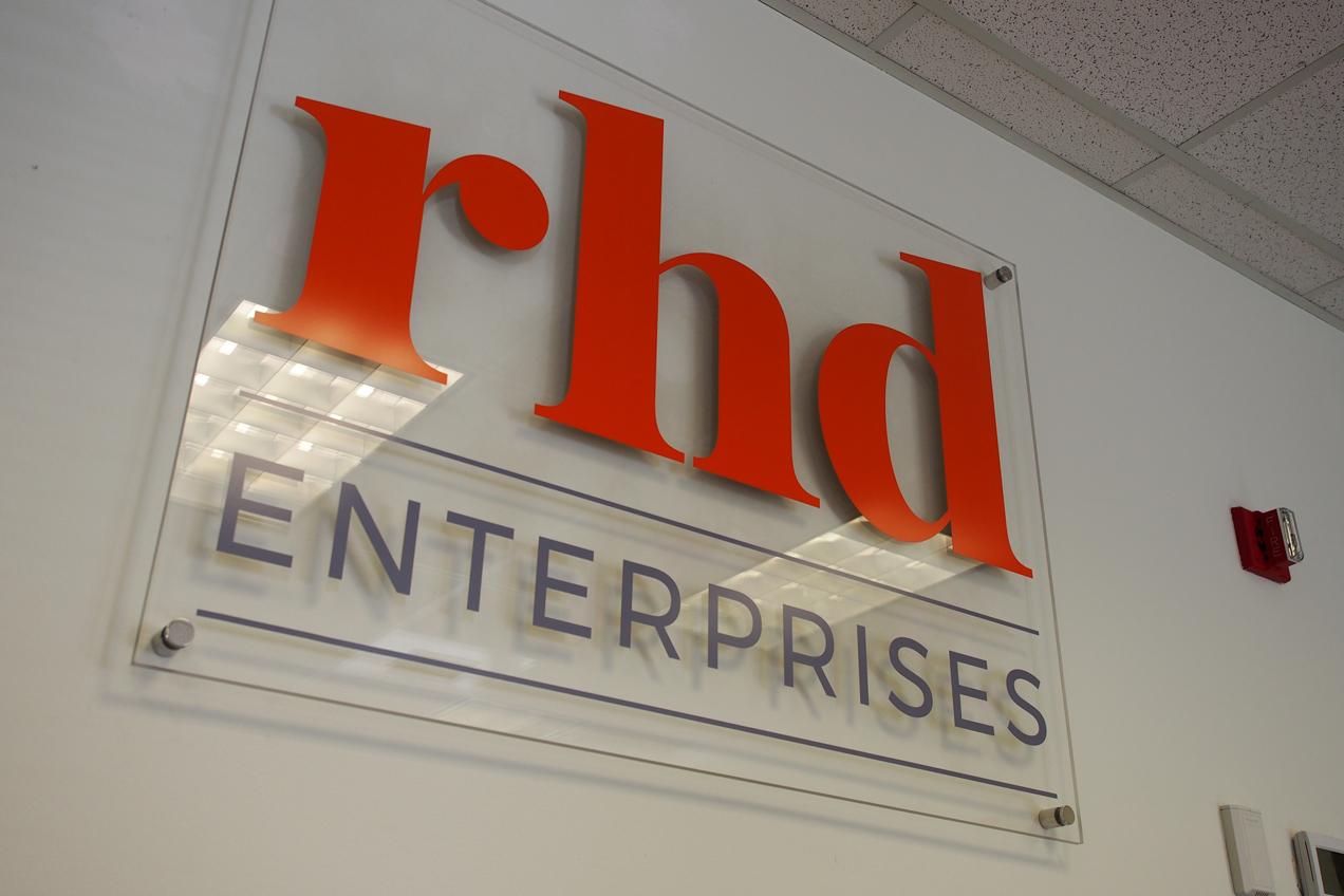 rhd logo on a plexiglass sign