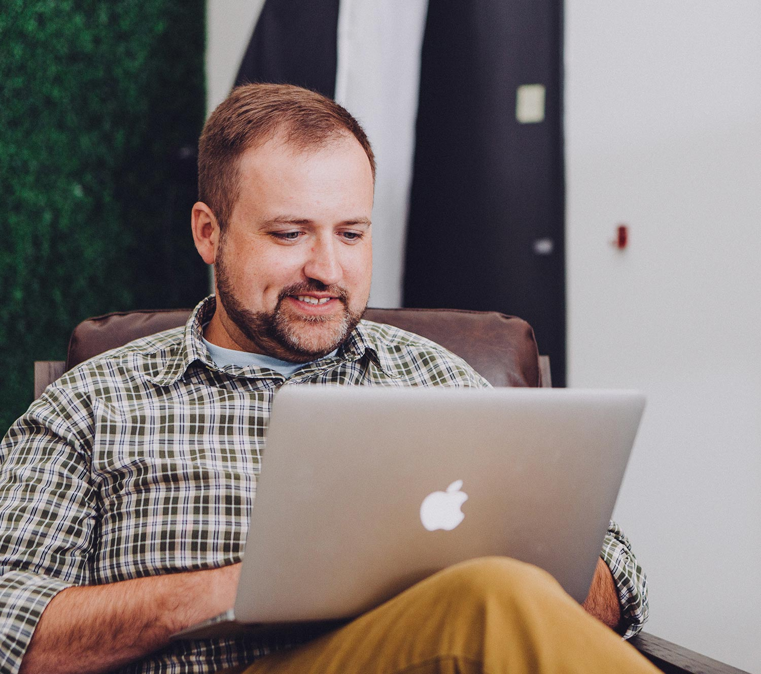 Man learning on his computer via the Guide platform