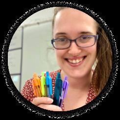 Teacher holding crayons