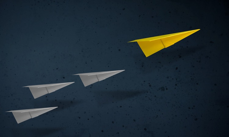 Four paper airplanes flying in a line.