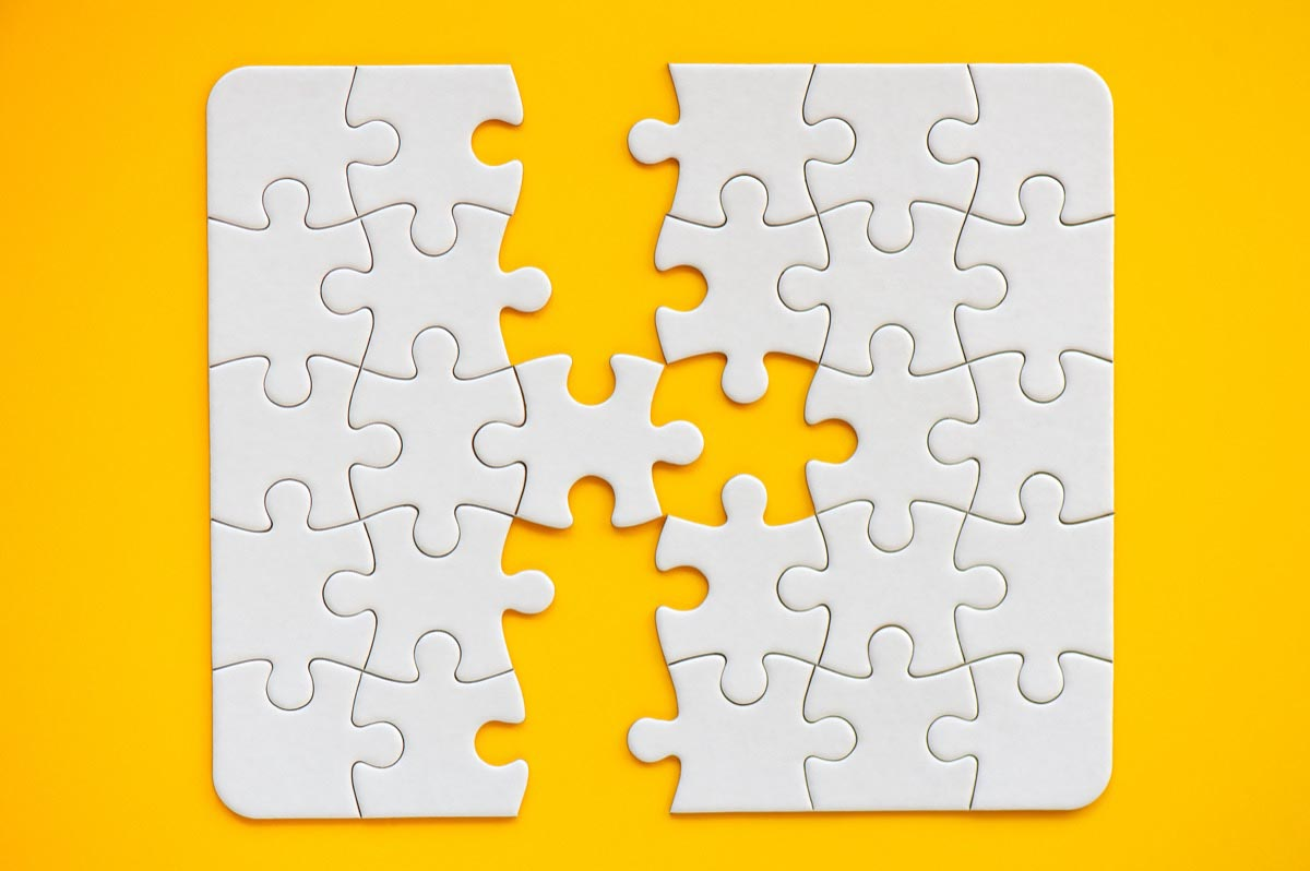 White puzzle pieces on a yellow background