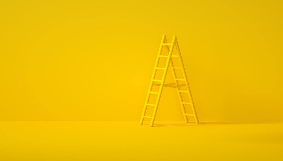 A yellow ladder on a yellow background