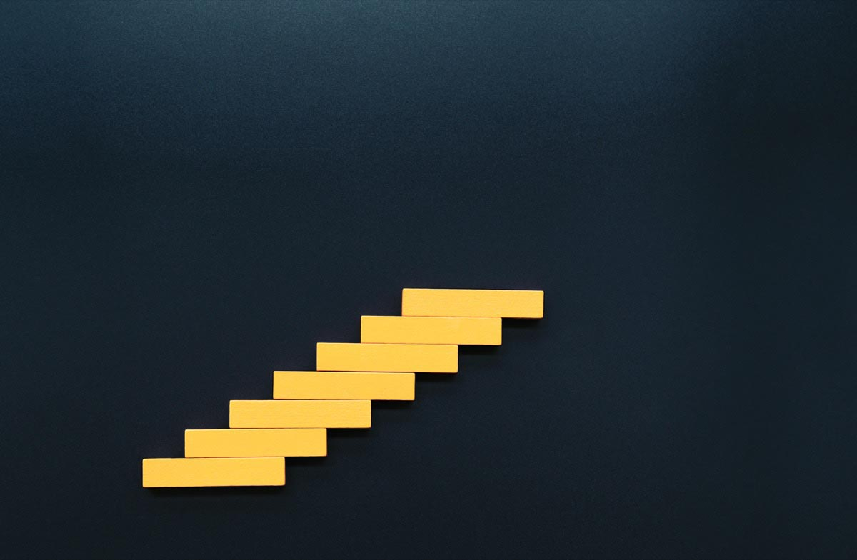 Stylized wooden yellow steps on a blue background