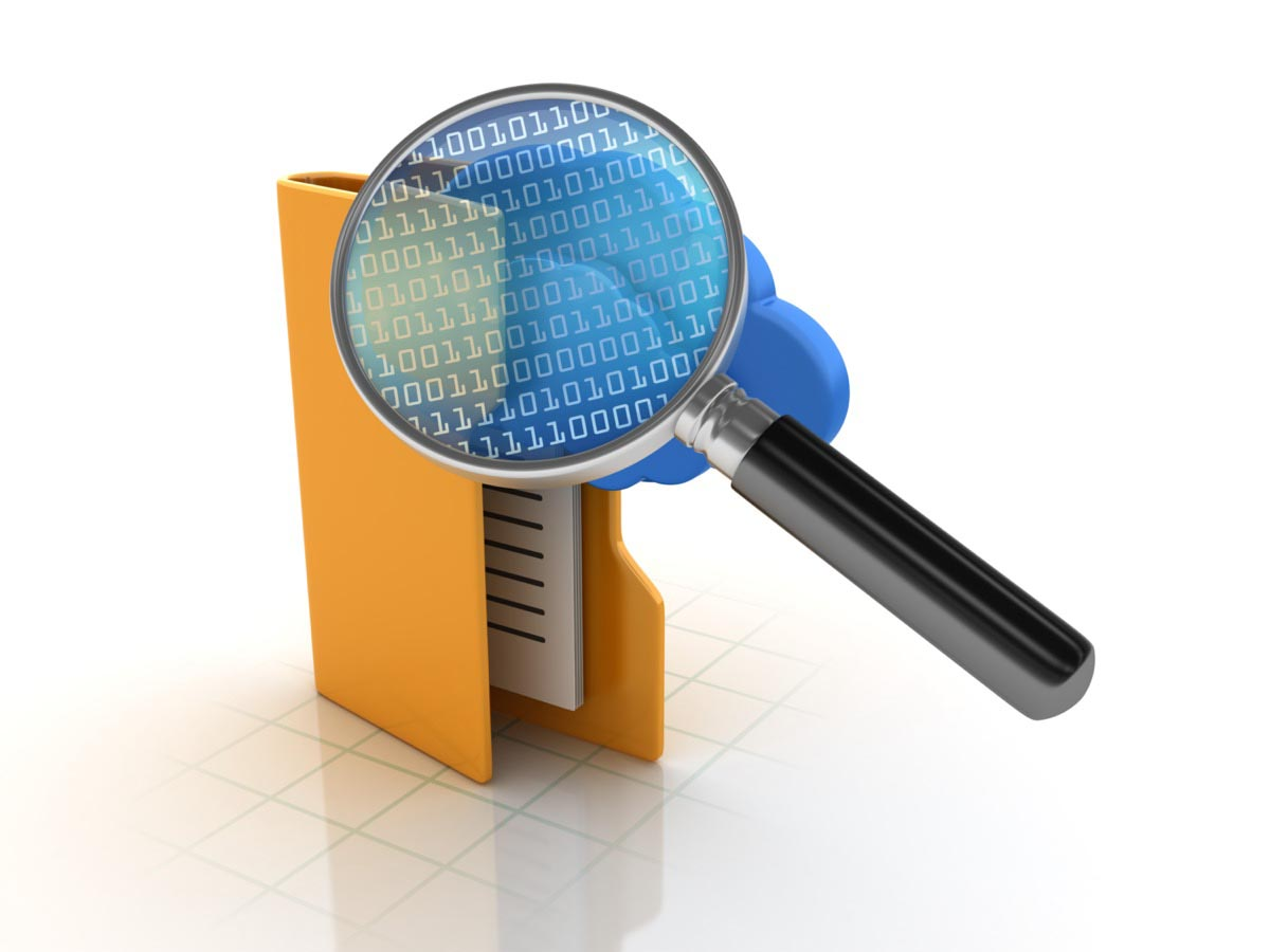A magnifying glass on a folder