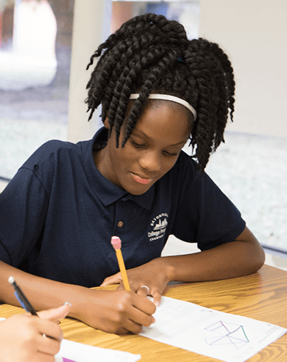 Young girl works through a geometry worksheet.