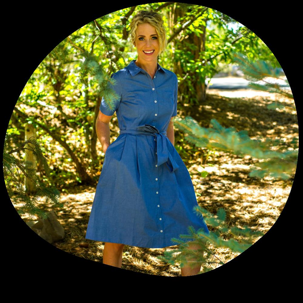 Mckenzie Ellis, founder of Low Salt Kitchen smiling in a blue dress