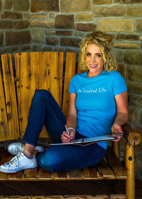 Mckenzie Ellis on a bench in her Unsalted Life tshirt