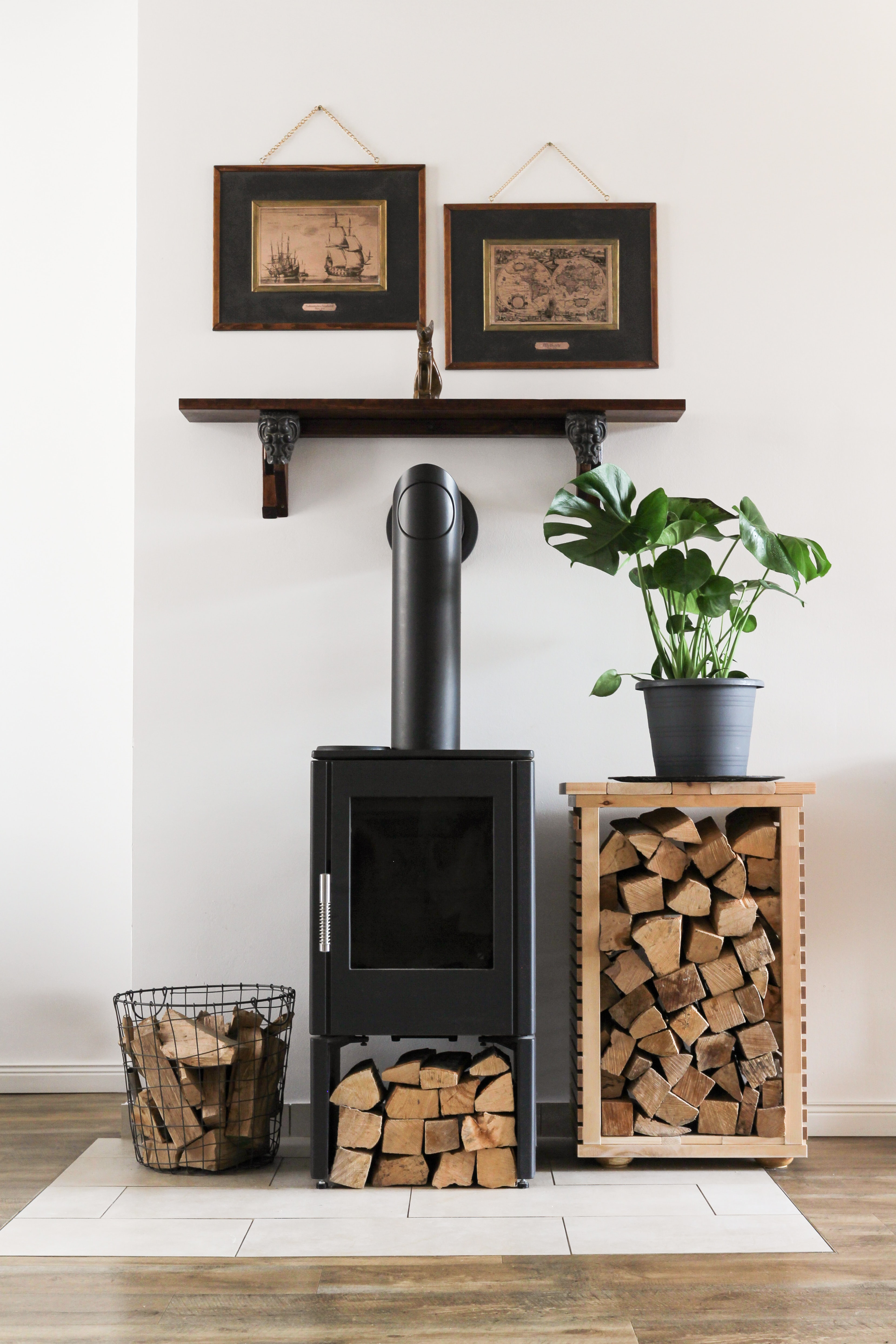 Fireplace in home with wooden logs place around it.