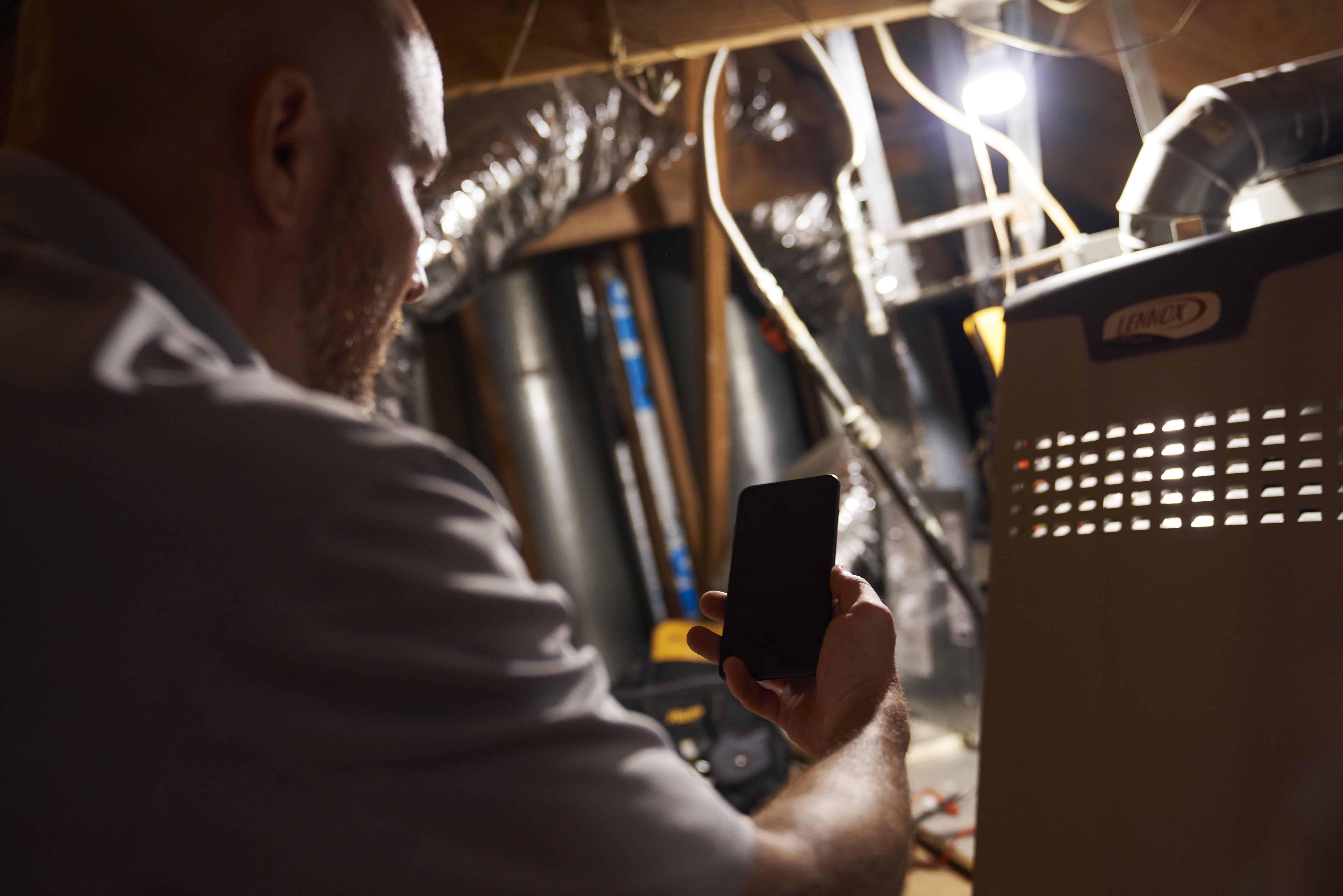 Technician servicing a HVAC system