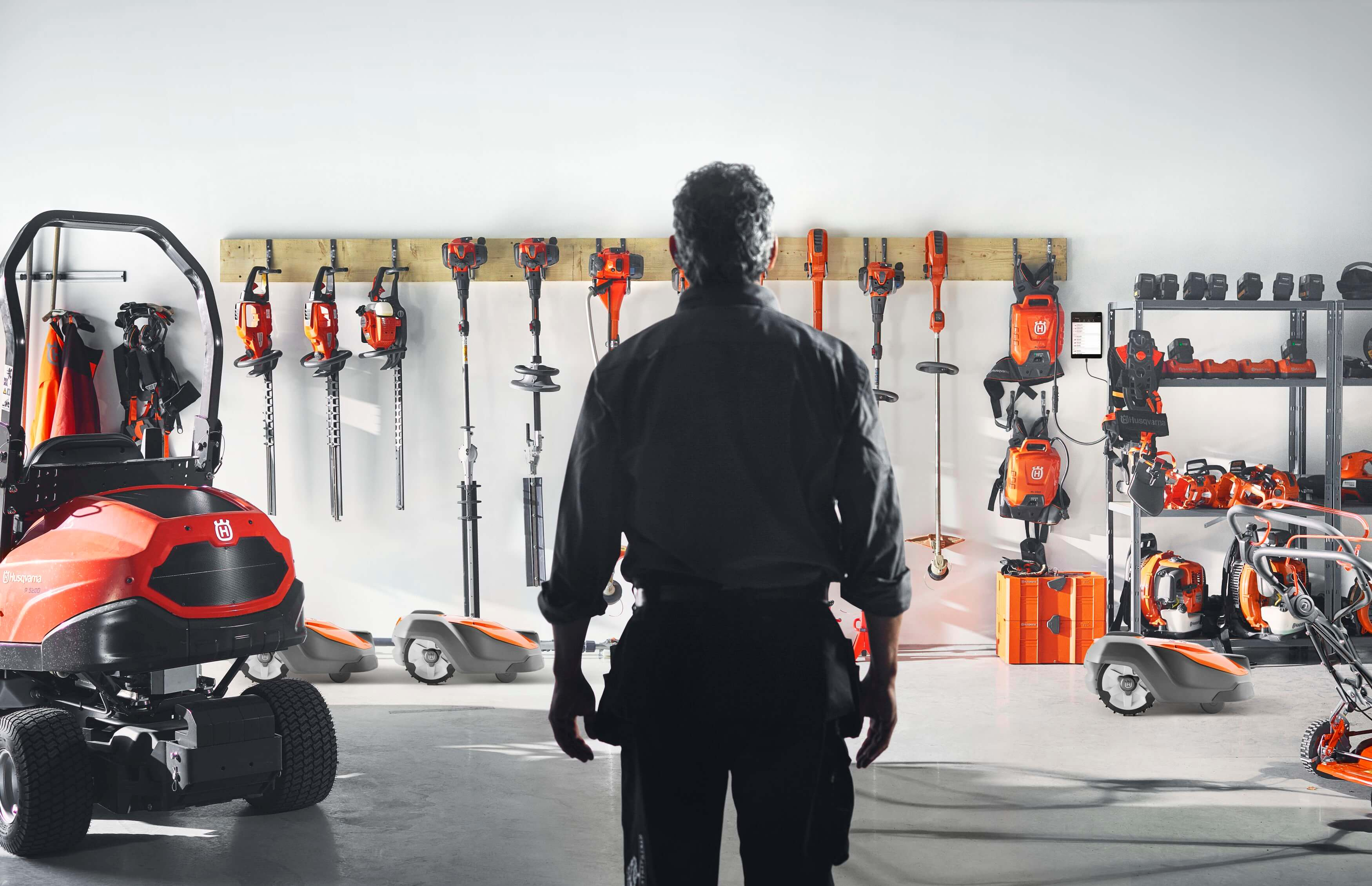 Husqvarna product wall with tools, and equipment