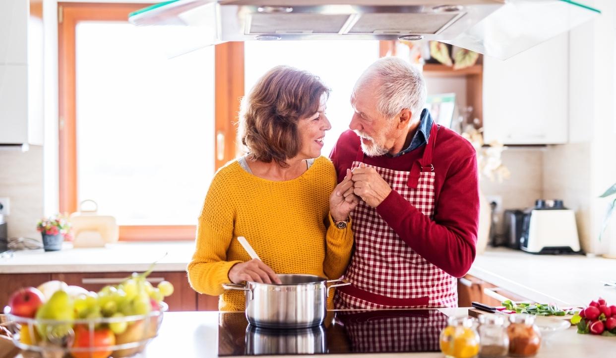 Senior couple in kitchen.
