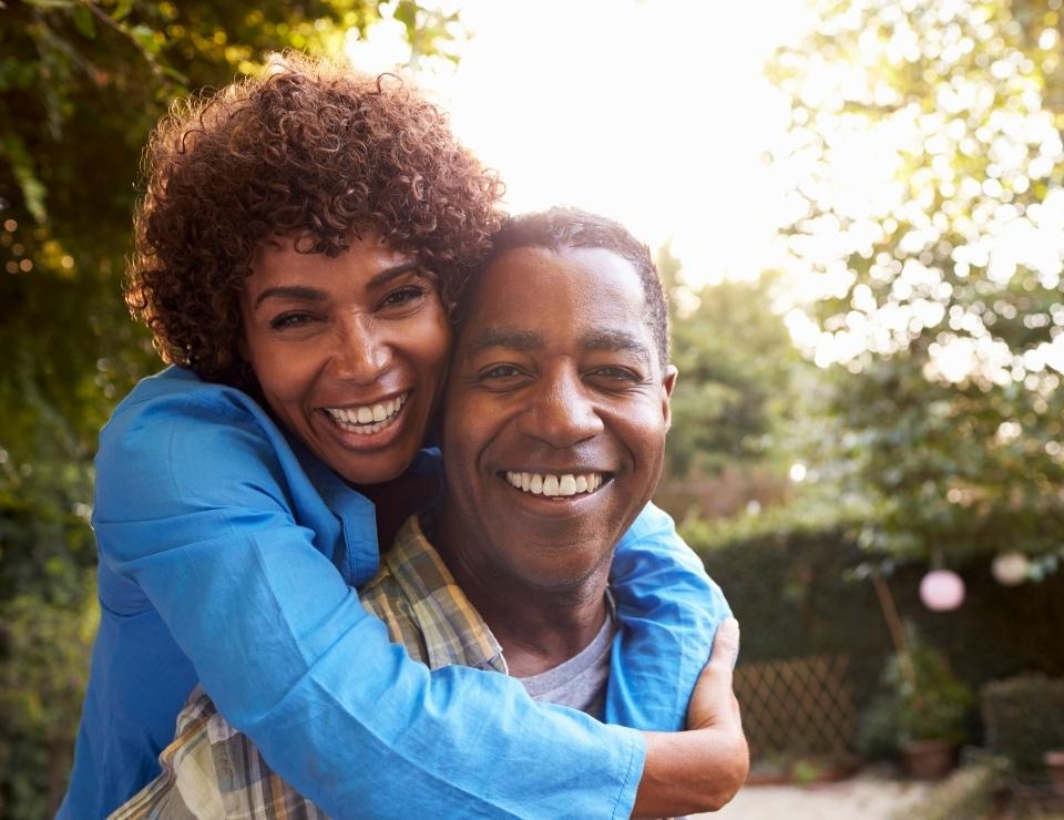 Mature couple smiling.