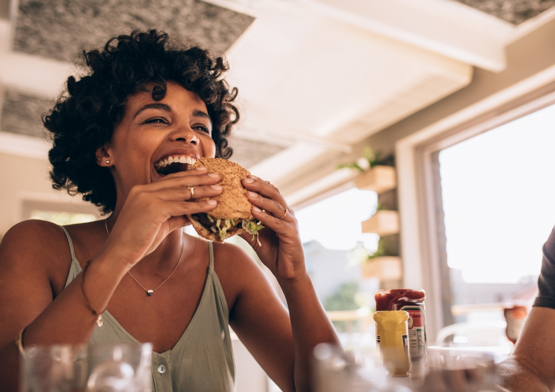 Woman eating burger.