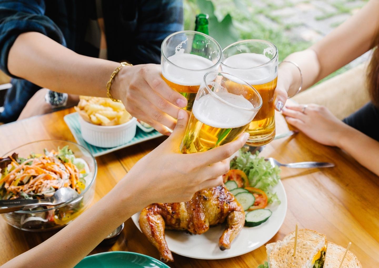 Friends cheers beer.