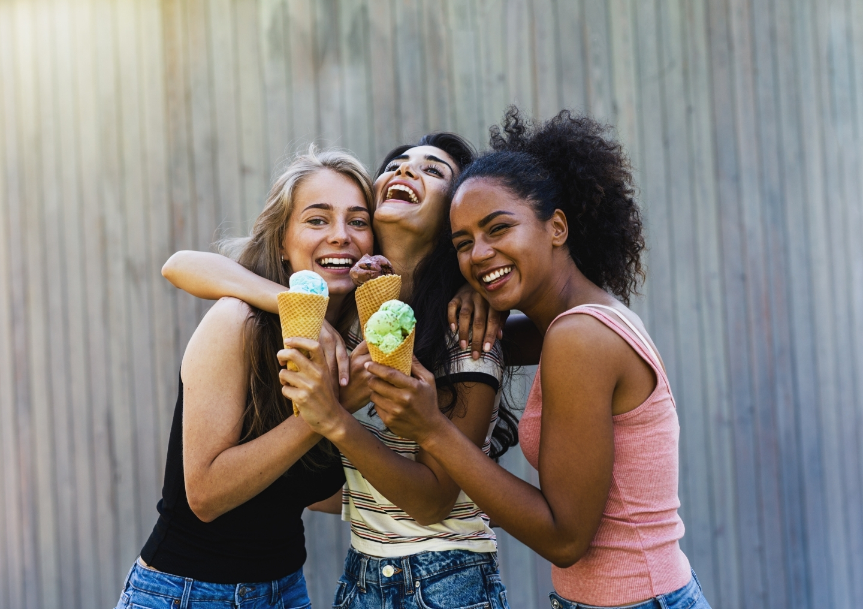Three girls with ice-cream.