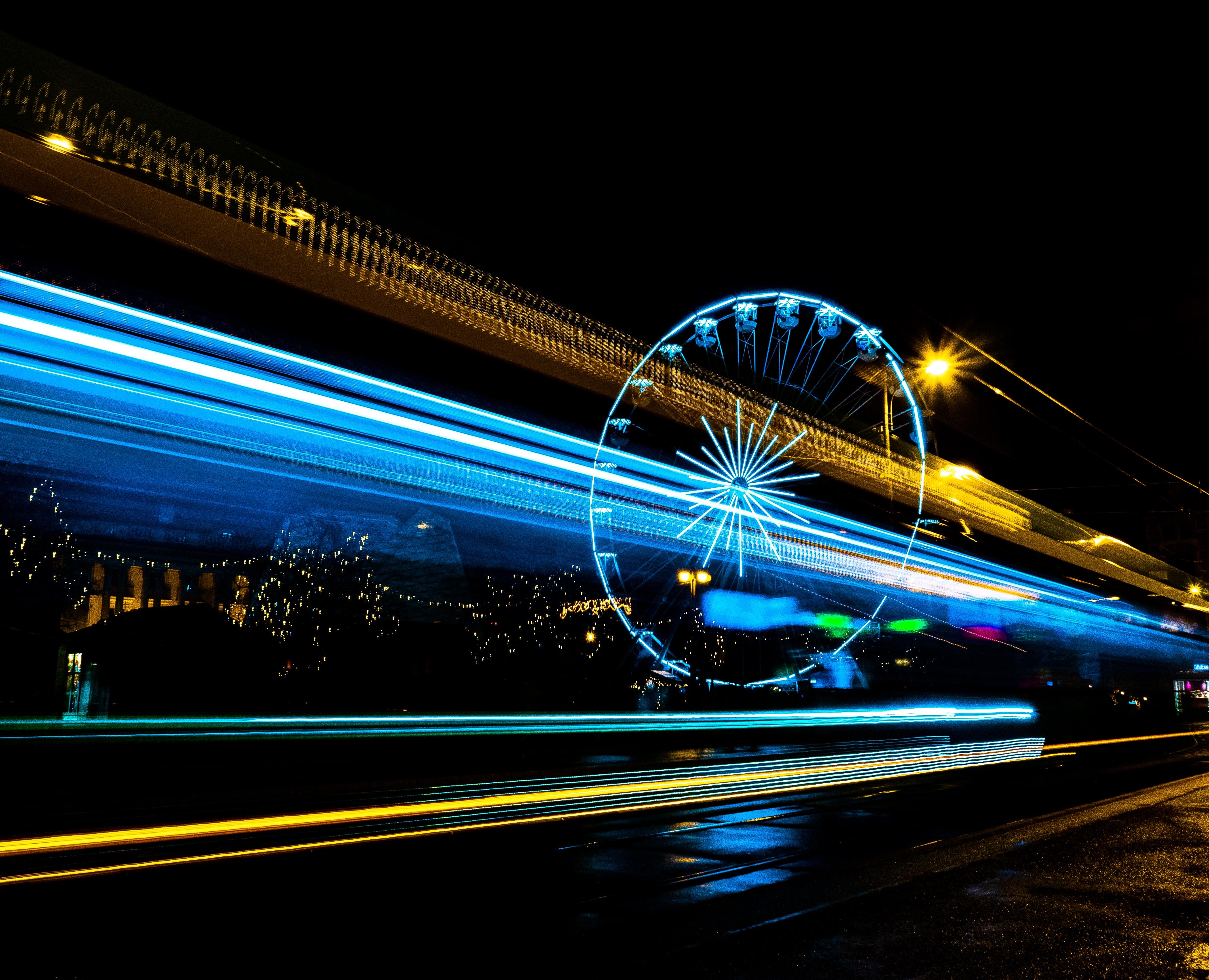 bright lights speeding through a dark sky, c. Radek Kilijanek, Unsplash